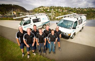 our Silver Spring plumbers standing proud in front of their vans